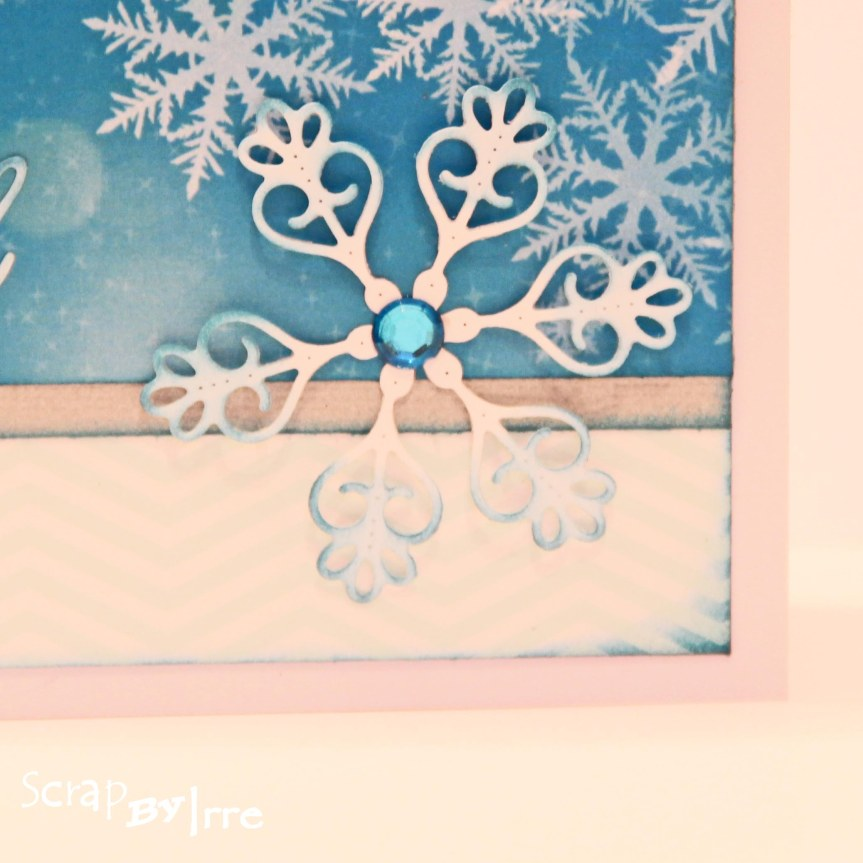 Christmas card with a blue snowy paper