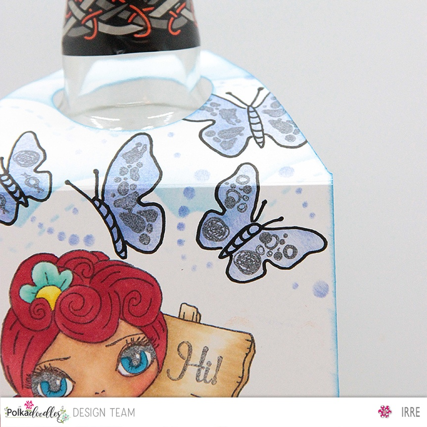 Bottle label with All about the journey together with somestencils